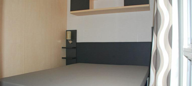 Chambre mobile-home naturiste